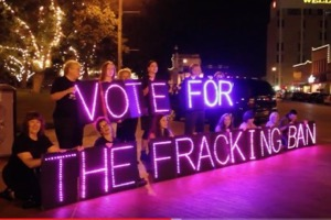 Denton fractivists light brigade