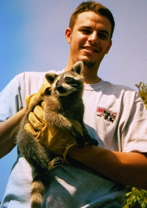 John Gaulden of 911Wildlife with raccoon