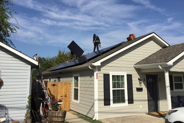 Afghan family gets help going solar in Plano.