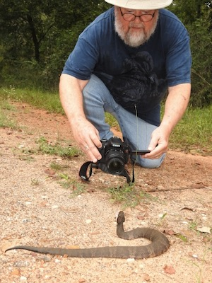 Michael Smith with cottonmouth snake