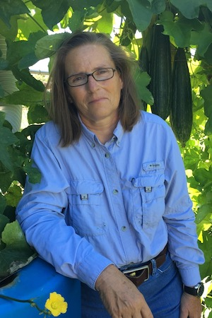 Deb Terrell with her luffa plants.