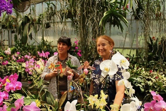 Andrea Ridout with Dotty Woodson and her orchids