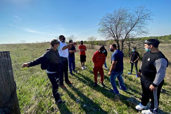 U.S. Congressman Marc Veasey talks with a group of young people hiking through remnant prairie near Benbrook Lake in southwestern Fort Worth.