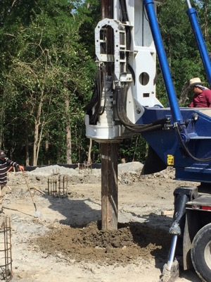 Ferrier Custom Home drilling pier and beam foundation