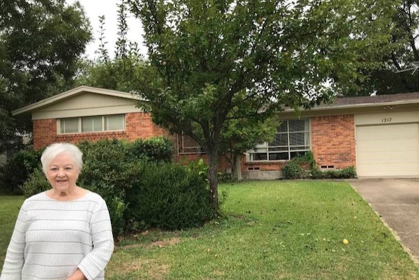 Rhonda Mullen at her former home on Bluebird Lane in Garland