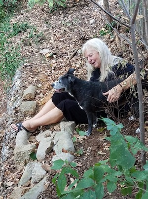 Tammie Carson and dog Baby on the banks of Kee Brook