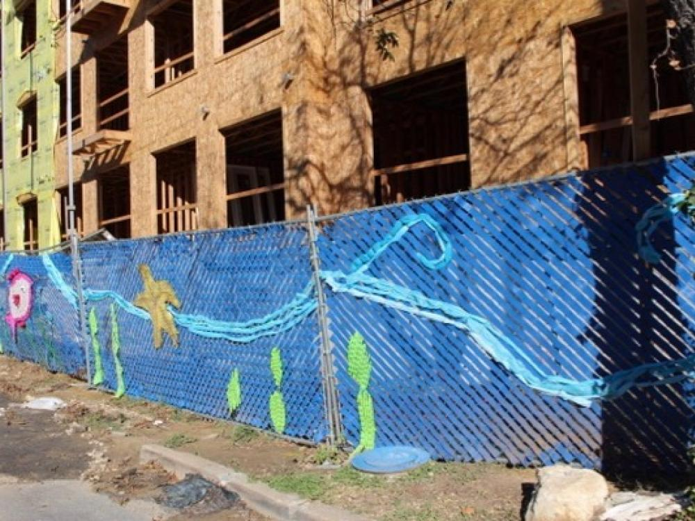 Recycling mural makes splash at dallas construction site for Construction mural